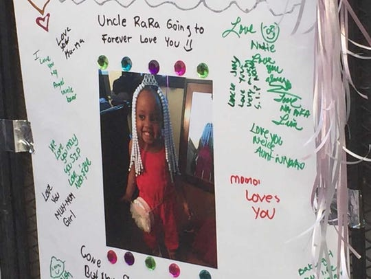 A memorial poster holds messages to 4-year-old Natalise