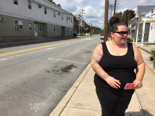 Deanna Colls tells the tale of how the boat wound up in the middle of Main Street in Windsor Wednesday night. You can still see the scrape marks extending for some 100 yards up the street.