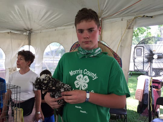 Brian Wacha, 14, of Port Jervis, with Coco, his Crested Polish Chicken.