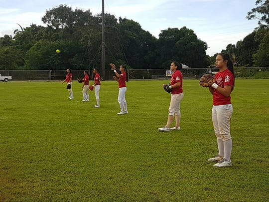The Guam National Girls Fastpitch Softball team at practice. The team is representing Guam in the Premier Girls Fastpitch National Championships in California.