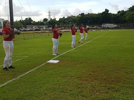 The Guam National Girls Fastpitch Softball team practicing.