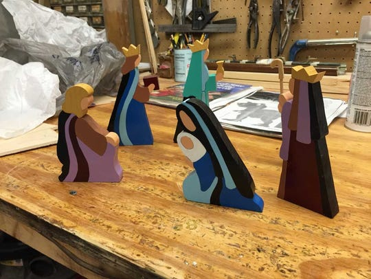 Bob Kuhn makes these wooden nativity scenes for Christmas.