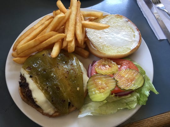 The Wednesday burger special at Jose's Family Diner, with chili and pepper jack cheese.