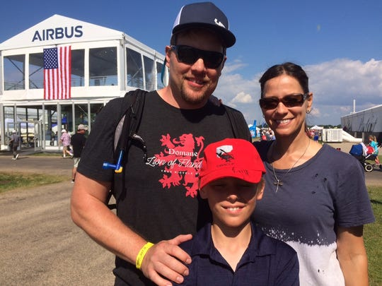Kurt and Meredith Heggland with their son Hakon at EAA AirVenture in Oshkosh Friday.