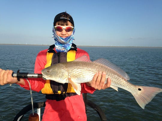 Benjamin Escamilla, 13, caught this 25-inch redfish while fishing in Nine-mile Hole.