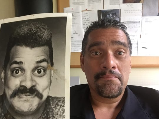 News columnist John A. Torres mugs it up with a promotional photo of Sinbad.