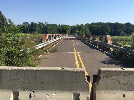 Concrete barriers are shown at one end of the Centerton Road Bridge.  A feasibility study was recently complete, and the county engineer recommends replacing the structure with a pedestrian bridge.