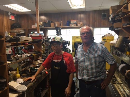 Longtime Cobbler Shop owner Mike McHale (right) is