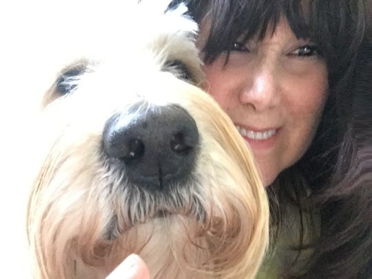 Toni Scott, wife of JEM Records' Marty Scott, and their Goldendoodle, Sherman.