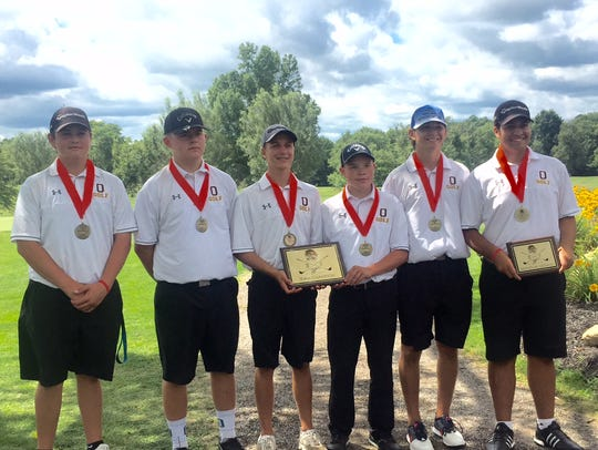 The Ontario golf team shows off its championship hardware