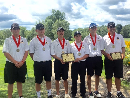 The Ontario golf team shows off its championship hardware at Friday's Tyger Invitational. Dominic Castelvetere (far right) was medalist with a 72.