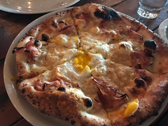 At Porta in Asbury Park, the carbonara pizza is topped