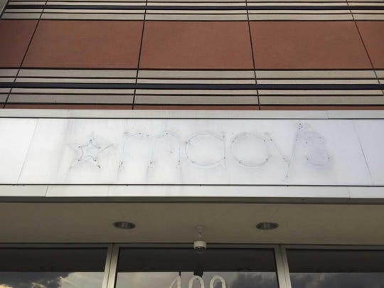 A ghost sign shows where a Macy's store operated at