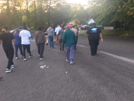 "Willingboro men walk from a nearby parking lot to the high school to greet the students on their first day of school. Called ""The Willingboro Welcome Back"", a local man, Jason Jones, created the event last year to show support for the students. Jones, a security guard at the school, is a Willingboro graduate, who created the organization Daddy Up, which creates and sponsors positive events in town."