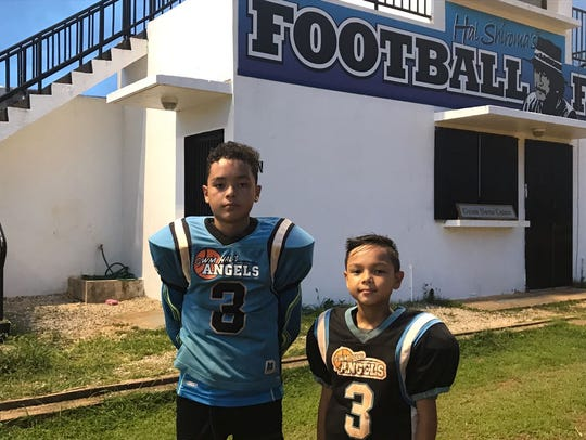 Blayz Topasna, left,  and Rayden Topasna, right, are
