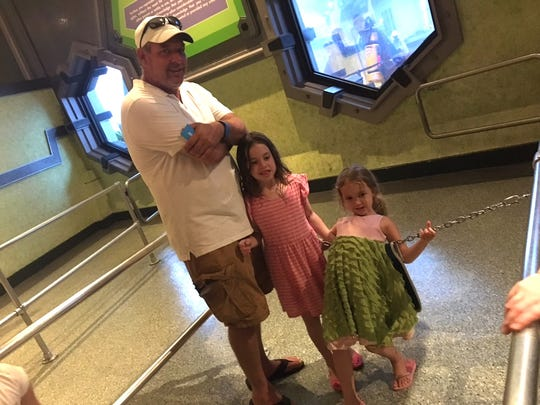 Rick Bartell and his daughters, Maddie and Olivia,