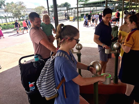 The Layton family of Tampa evacuated to Orlando to stay with family. What to do to ward off cabin fever Friday? A trip to Magic Kingdom for this trio, who are Disney passholders.