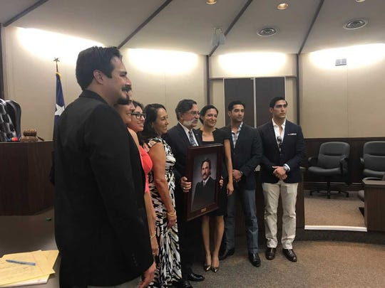 Judge J. Manuel Bañales' poses with his family for
