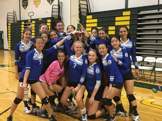 The Millburn Millers celebrate with its Silver Bracket trophy at the Morris Knolls September Slam tournament. (L to R) Front Row: Mia Achitoov, Lucia Singer, Georgie Brosius, Sarah Shaykevich, Stephanie Tom, and Jennifer Guo. Middle Row: Jessica Toledo, Taylor Liu, Lais Santos, and Thais Silva. Back Row: Chloe Nimmer, Stephanie Bai,Iveel Boldbaatar, Amanda Huang, and Olivia Goldenberg.