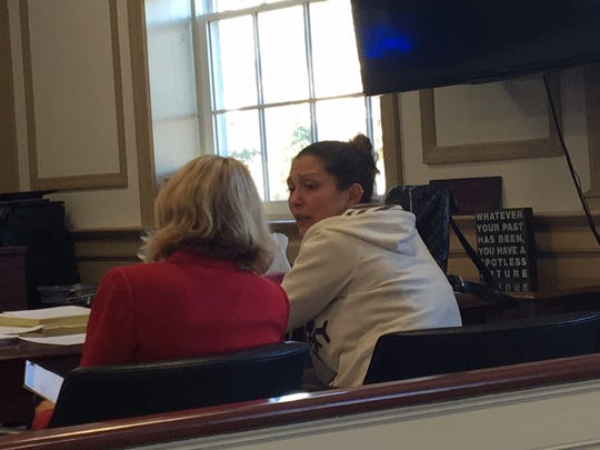 Natasha Rivera, in white, speaks to her attorney, Elizabeth Martin, at her sentencing in Morristown on Sept. 22, 2017 for accessing confidential information to hurt a romantic rival.