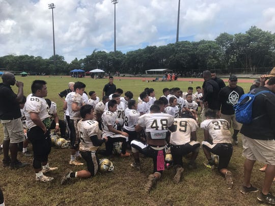 Titans listen to their coaches after a win over the Dolphins 19-0. Tiyan had three touchdowns taken away because of penaties. The Titans are now 3-2, and the Dolphins are 0-5.