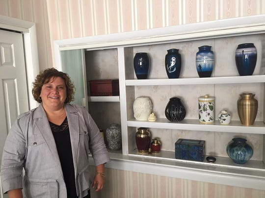 Jill Bradley Ingram, manager at Bradley Funeral Home in Marlton, stands near urns and boxes that the funeral homes offers families for their loved ones after cremation. The U.S. cremation rate topped 50 percent for the first time in 2016. Cremations have exceeded the burial rate in the U.S. two years in a row. By 2035, experts predict cremation rates will be at nearly 79 percent in the U.S.