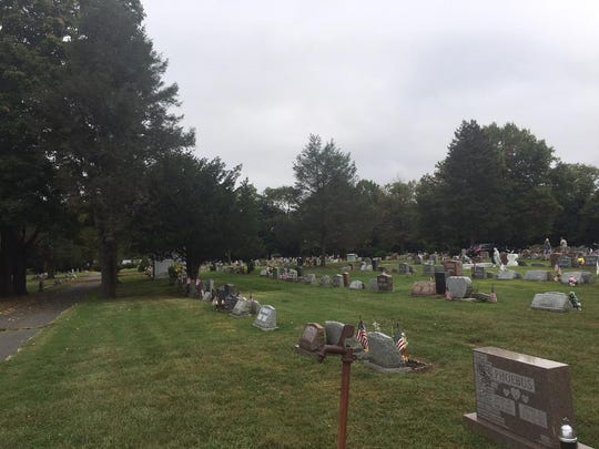 Flags can be seen on graves at Mount Holly Cemetery in Burlington County. Thieves have stolen about 200 bronze veteran grave markers from the cemetery in the last few weeks. The markers have a place were an American flag can be inserted. Some of the graves with only flags are the ones where the markers were stolen.