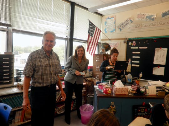 On Sept. 19th the Morris Plains Rotary Club distributed dictionaries to every third grader at the Borough School. This is an ongoing project that has been organized to promote literacy while giving each of the children a dictionary that he/she will be able to use throughout his/her life.  Pictured: Rotarians Steve Rosenstein and Denise Goetting talk with third grade teacher Beth Viegas about the project.
