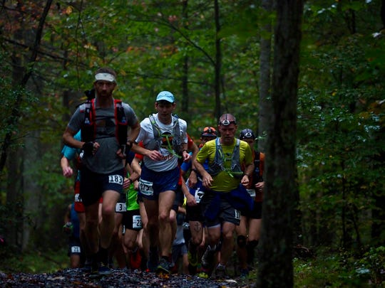 Every 6 to 8 miles are aid stations for Grindstone 100 runners with food and water, along with crew members ready to supply socks, a jacket for night or to recharge headlamps worn by runners.
