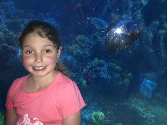 Marisa Tufaro pictured at the New England Aquarium in August 2014 a day before she became ill and was admitted to Boston Children's Hospital.