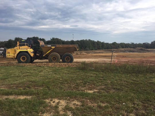 A construction vehicle is shown where land has been cleared for the Topgolf Mount Laurel, which will be built soon near the corner of Centerton Road and Marne Highway in Mount Laurel.