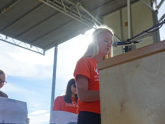 Lindsay Mouw speaks on climate change during a rally