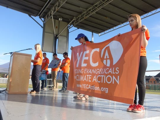 Lindsay Mouw speaks during a rally as a leader of Young Evangelicals for Climate Action.