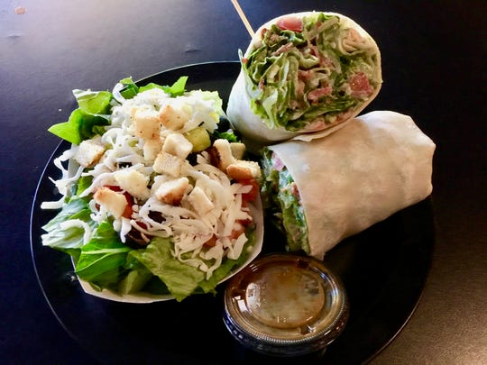 The BLTA wrap with a side salad at Maxwell's Eatery in Redding.