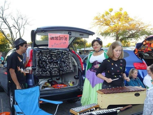 """Members of Floral Heights United Methodist Church dress up in costume to offer """"trunk or treating"""" in the church parking lot. This year, Floral Height's event is from 5-7 p.m. Oct. 29."""