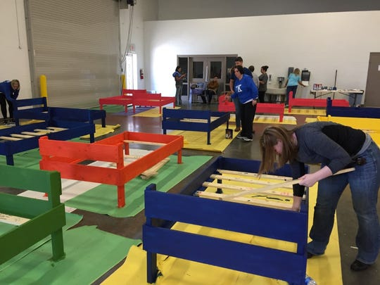 In this file photo, volunteers put finishing touches on 30 beds during the annual Build-a-Bed project held by the Volunteer and Information Center.