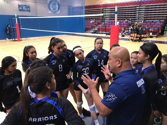St. Paul Warrior coach Al Garrido talks to his team during the finals of the ASCS Girls Volleyball Tournament