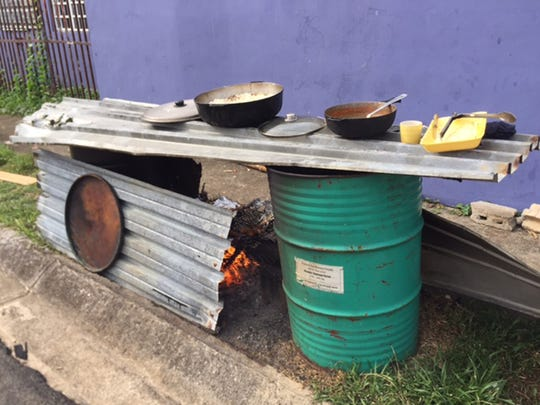 A family made this barbecue from the tin roof peeled off their home by the hurricane.