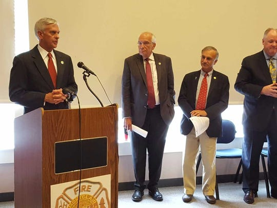 NJ Board of Public Utilities President Richard S. Mroz, at the podium, speaks on Oct. 11 about the importance of having microgrids in Montclair and other municipalities. Alongside Mroz are, from left, NJBPU Commissioner Joseph L. Fiordaliso, Montclair Township Councilmember Robert Russo, and acting Township Manager Timothy F. Stafford.