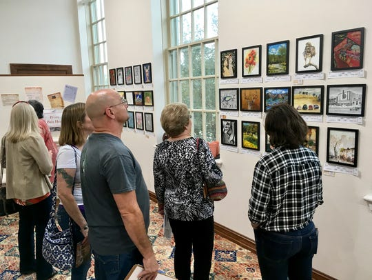 In this file photo, art lovers visit the Kemp Center for the Art's NorthLight Gallery to check out Mystery Art and to make bids. Steve HIlton will present a gallery talk 5:30 to 7 p.m. Oct. 25.