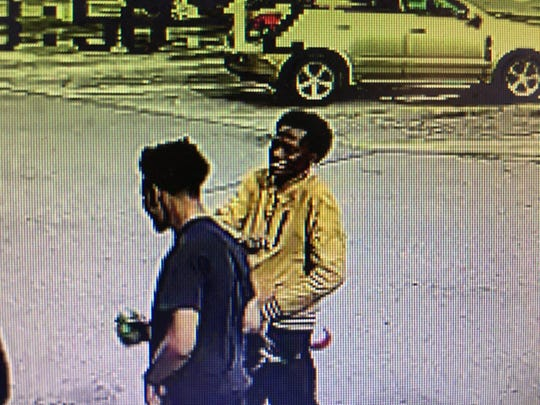 The surveillance photo captured two of the suspects police are seeking.