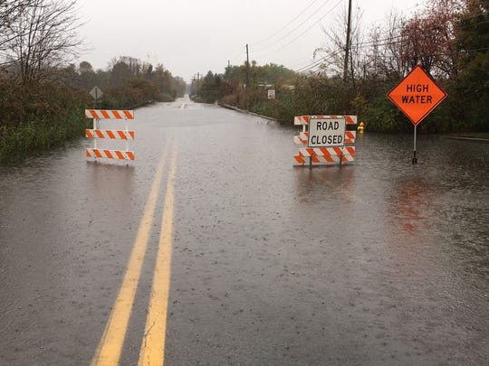 Low lying areas, like parts of Airport Road in New Castle, are flooded from today's rain.