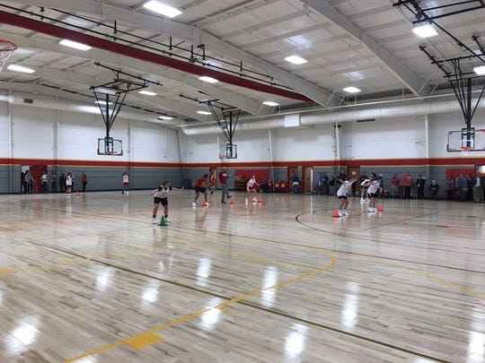 The Mater Dei girls basketball team practices in the new auxiliary gym Monday, Oct. 30.