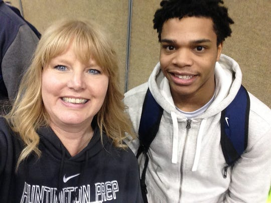 Susan Bouchillon and Miles Bridges at a Hungtington Prep basketball game in Huntington, West Virginia, in January, 2015. Bridges lived with Bouchillon and her family.