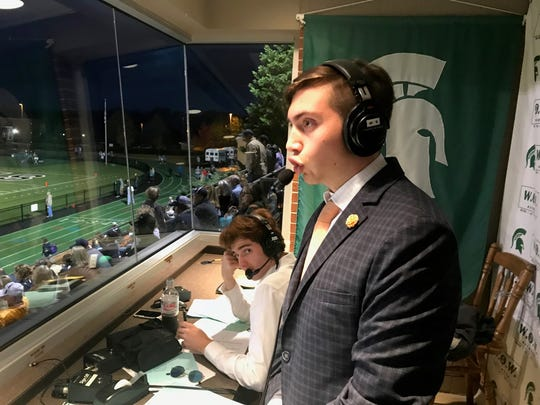 Peyton Gallaher, standing, does some play-by-play announcing for Webb's W.O.W. Network while Jack King listens.
