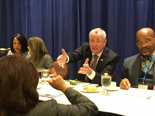 Gov.-elect Phil Murphy, center, at the New Jersey State