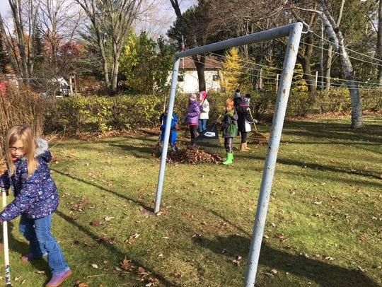 Hatley Elementary students rake leaves to help older