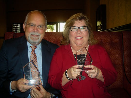 Michael Henson and Susan Moffitt were among those honored at the National Philanthropy Day luncheon.