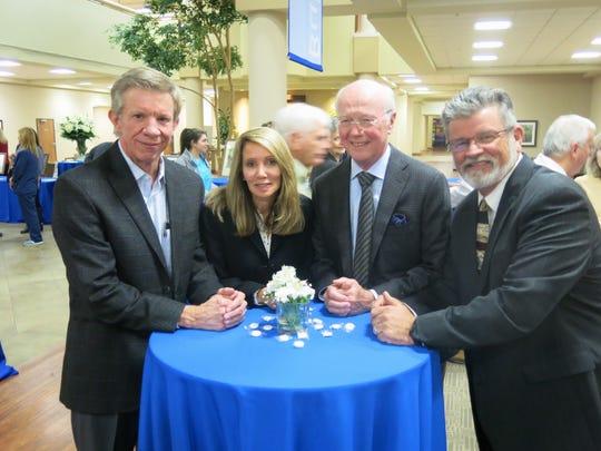 Dr.  Charles Knight, Debbie Smith, Dr. Gordon Mead and Dr. Geoffrey Garrett at Highland Clinic celebration.