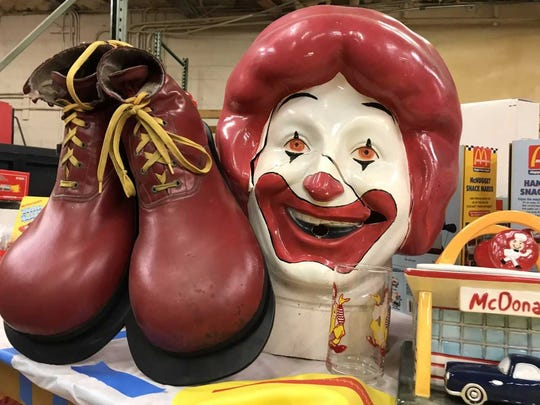 A Ronald McDonald head with a nozzle to blow up balloons and Ronald McDonald boots are among the thousands of vintage McDonald's memorabilia pieces that will be auctioned Dec. 9, 2017, to benefit Ronald McDonald House Charities of Northwest Florida.